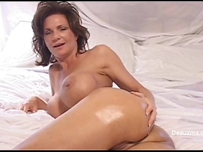 beautiful mature woman assumes her beautiful ass as oil smeared and sensually ca