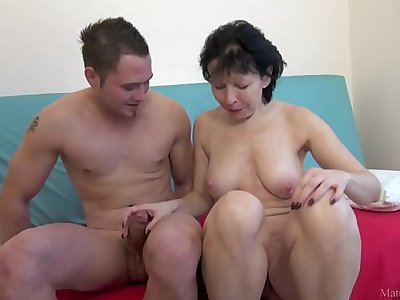Mature lady seduced a young fellow and fucked him doggystyle